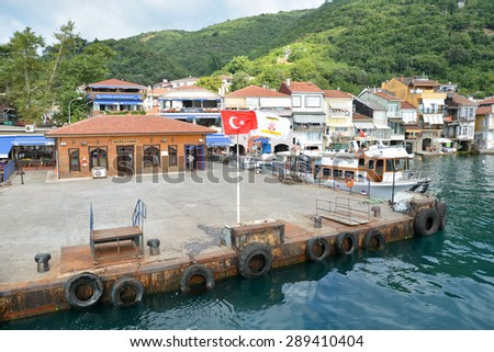 ISTANBUL, TURKEY, JUNE 8, 2013 : Pier of Anadolu Kavagi, a famous fishing town at the edge of Bosphorus with many restaurants and touristic facilities. Attraction point for tourists. - stock photo