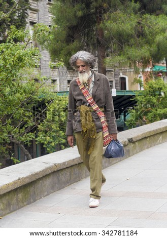 Istanbul, Turkey - June 15, 2014: Poor indian man walks in Istanbul street with a bag on his neck