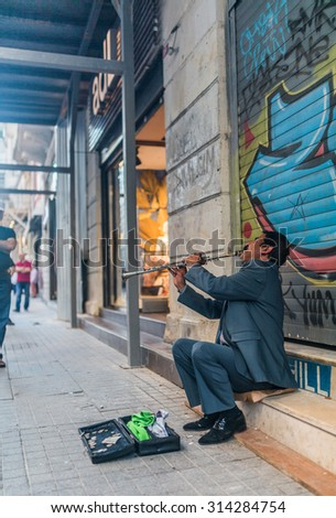 ISTANBUL, TURKEY - JUNE 20: Street musician on June 20, 2015 in Istanbul, Turkey - stock photo