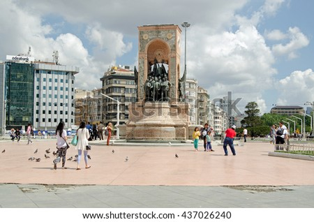 ISTANBUL, TURKEY - JUNE 5, 2016:  Tourists and locals enjoying the sunshine and view at the Republic Monument in Taksim Square on a sunny summer morning.