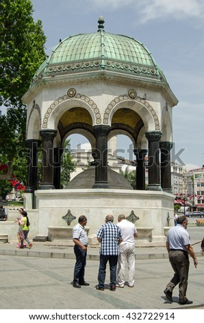 ISTANBUL, TURKEY - JUNE 3, 2016: Tourists and locals enjoying the sunshine beside the landmark German Fountain in Sultanhamet, Istanbul.  The monument marks the visit of Emperor Wilhelm II in 1898. - stock photo