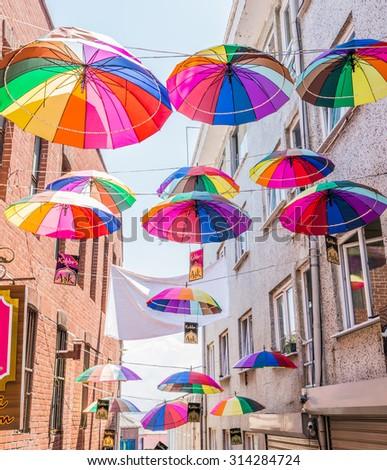 ISTANBUL, TURKEY - JUNE 20: Umbrellas near street cafe on June 20, 2015 in Istanbul, Turkey - stock photo