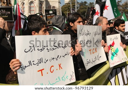 ISTANBUL, TURKEY-MARCH 2: A group of people stage a demonstration in front of the Beyazit Mosque, protesting Syrian authorities' violent crackdown in Homs, on March 2, 2012 in Istanbul,Turkey - stock photo