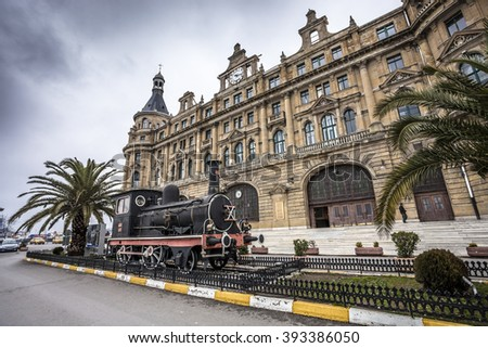 ISTANBUL, TURKEY - MARCH 20, 2011:  Exterior of Haydarpasa train station with steam locomotive in front. It  is the busiest railway terminal in Turkey. - stock photo