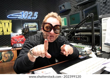 ISTANBUL, TURKEY - MARCH 12: Famous Turkish Radio DJ, show host and television star Cem Ceminay portrait on March 12, 2006 in Istanbul, Turkey. - stock photo