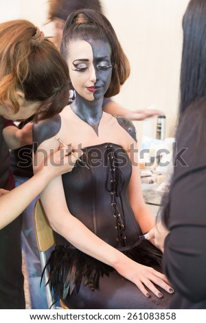 ISTANBUL, TURKEY - MARCH 15, 2015: Girl body painting Work shop in Beauty and Care exhibition in Istanbul