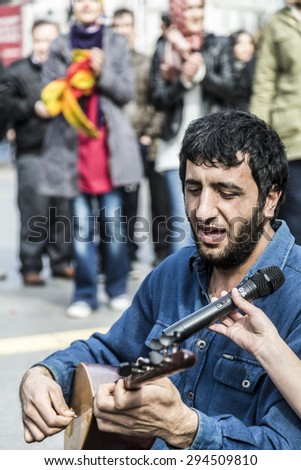 Istanbul, Turkey - March 12, 2015: Kurdish people living in Turkey singing and dancing on a marching day in Kadikoy district of Istanbul, taken on March 12, 2015 - stock photo