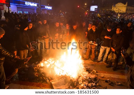 ISTANBUL, TURKEY - MARCH 11, 2014: People create barricades and fire in Kadikoy to protest after Berkin Elvan, who was 15 years old, died. He was hit in the head with a tear gas canister by Police.