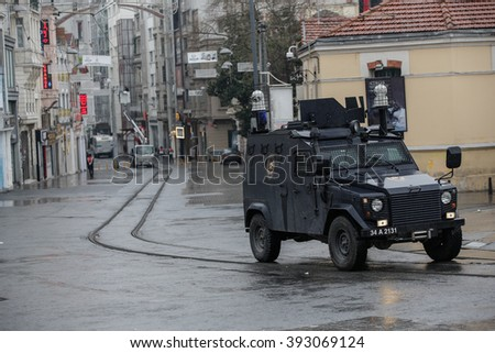 ISTANBUL, TURKEY - MARCH 19: Police cars stand in a cordon off street after a suicide bomb attack at Istiklal Street in Istanbul on March 19, 2016 in Istanbul, Turkey. - stock photo