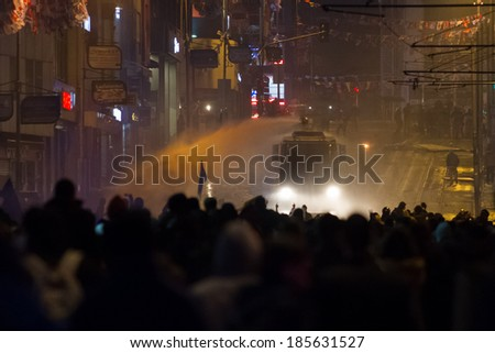 ISTANBUL, TURKEY - MARCH 11, 2014: Police intervene with water cannon in Kadikoy during protest after Berkin Elvan who was 15 years old, died. He was hit in the head with a tear gas canister by Police