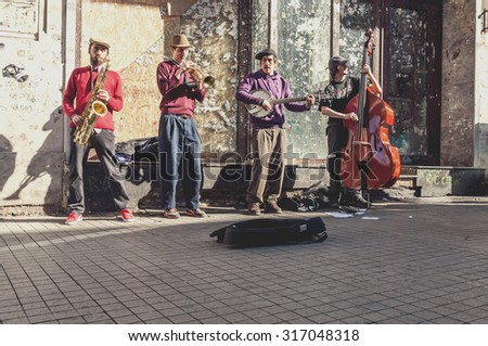 Istanbul, Turkey - March 23, 2011: Street musicians performing with their instruments in Istiklal Avenue, Istanbul. The avenue is a popular spot for locals and tourists with its 24/7 vivid lifestyle. - stock photo