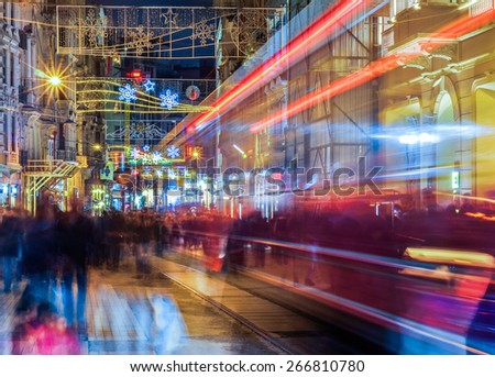 ISTANBUL, TURKEY - March 29: Taksim Istiklal Street at evening on March 29, 2015 in Istanbul, Turkey. Taksim Istiklal Street is a popular destination in Istanbul. Nostalgic tram of Istanbul.  - stock photo