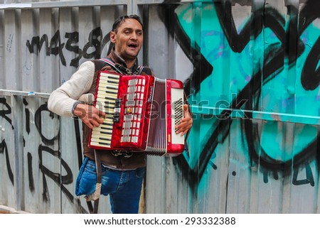ISTANBUL, TURKEY - MARCH 23: The busker playing accordion on March 23, 2015 in Istanbul - stock photo