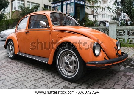 ISTANBUL, TURKEY - MARCH 25, 2016:Vintage orange Volkswagen Beetle parked on a street in Istanbul