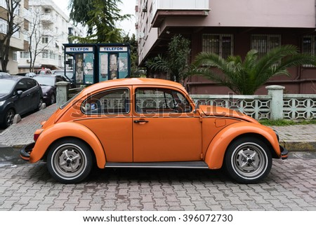 ISTANBUL, TURKEY - MARCH 25, 2016:Vintage orange Volkswagen Beetle parked on a street in Istanbul  - stock photo