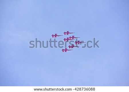 """ISTANBUL, TURKEY - May 29: Aerobatic group formation """"Turkish Stars"""" at blue sky during celebration of the conquest of Istanbul on May 29, 2016 in Istanbul, Turkey - stock photo"""