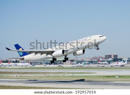 ISTANBUL , TURKEY - MAY 16, 2014: Aircraft of Saudi Arabian Airlines, is taking off from Istanbul Ataturk International Airport on May 16, 2014. The aircraft is an Airbas A 312 - stock photo
