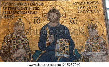ISTANBUL, TURKEY - MAY 18, 2014 - Christ enthroned, flanked by Empress Zoe and her 3rd husband Constantine IX Monomachus, Byzantine mosaic in the gallery of  Hagia Sophia  in Istanbul, Turkey - stock photo