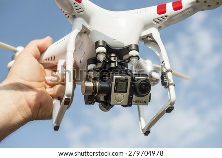 ISTANBUL, TURKEY - MAY 19, 2015: Drone quadrocopter Dji Phantom 2 with digital camera GoPro HERO4 Black edition. New tool for aerial photo and video. - stock photo
