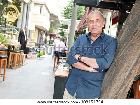 ISTANBUL, TURKEY - MAY 30: Famous Turkish businessman, business manager and former Besiktas Sport Club manager Erol Kaynar portrait on May 30, 2013 in Istanbul, Turkey. - stock photo