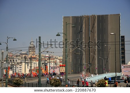ISTANBUL, TURKEY - MAY 01, 2013: Historical Galata Bridge looking on may 01, 2013 in Istanbul. It is a bascule bridge which is 490 m long and connects Karakoy Region to Old City.