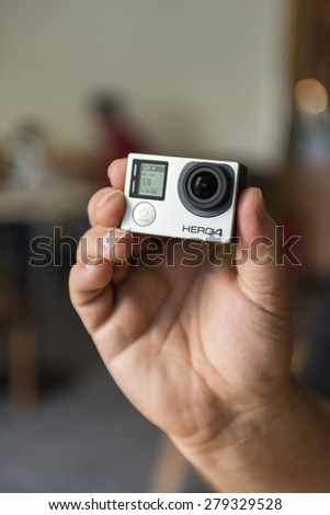 ISTANBUL, TURKEY - MAY 19 ,2015:Man holding Gopro Hero 4.Gopro action camera in hand.Shot of GoPro Hero 4 Black.It is a compact, lightweight personal camera manufactured by GoPro Inc.