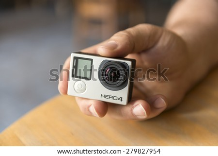 ISTANBUL, TURKEY - MAY 19 ,2015:Man holding Gopro Hero 4.Gopro action camera in hand.Shot of GoPro Hero 4 Black.It is a compact, lightweight personal camera manufactured by GoPro Inc.  - stock photo