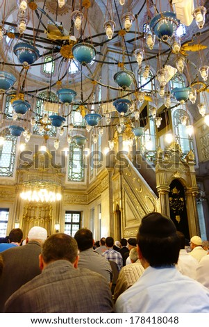ISTANBUL, TURKEY - 2 MAY, 2013: Muslim men gathered in Eyup Sultan Mosque for the afternoon prayer. This mosque has been built by the Ottomans in 1458 just beside the tomb of Abu Ayyub Al Ansari. - stock photo