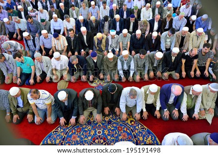 ISTANBUL, TURKEY - MAY 17: noon prayer in congregation male Muslims Fatih Mosque on May 17, 2014 in Istanbul, Turkey. Soma for mine workers who died in the memorial program. - stock photo