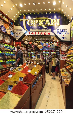 ISTANBUL TURKEY  May 25 2014: People shopping in the Grand, Spice Bazaar  one of the largest covered markets in the world - where locals, visitors shop regularly.  - stock photo