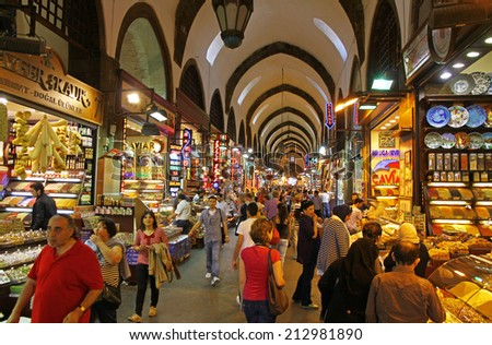ISTANBUL, TURKEY - MAY 6, 2012: People shopping inside the Grand Bazar in Istanbul, one of the largest and oldest covered markets in the world - stock photo