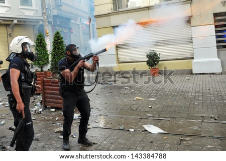 ISTANBUL, TURKEY - MAY 31: Police intervenes Gezi Park demonstrators with pepper gas at Taksim on May 31, 2013 in Istanbul, Turkey. - stock photo