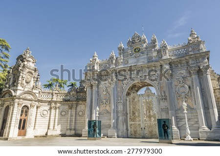 ISTANBUL, TURKEY, MAY 14, 2015: Policemen keeping guard in front of Gate of The Sultan, Dolmabahce Palace, Istanbul, Turkey. - stock photo