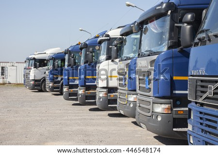 ISTANBUL, TURKEY - MAY 30, 2016: 1998 Swedish Volvo FH12, 4000cc, 475 HP Semi-trailer truck and other trucks at truck garage in Istanbul, Turkey - stock photo