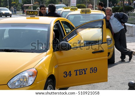 ISTANBUL, TURKEY - MAY 05, 2009: Taxi driver waiting for customers in the city center