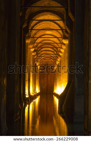 ISTANBUL, TURKEY - MAY 6, 2014: The famous Basilica Cistern, the largest of several hundred ancient cisterns that lie beneath the city Istanbul, Hundreds of tourists visit it yearly.