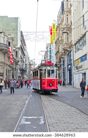 ISTANBUL, TURKEY - MAY 2, 2015: Tram riding through the city, past the people, buildings