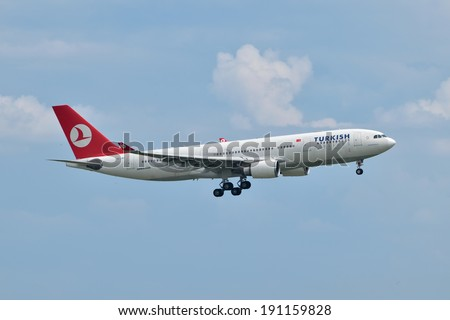 ISTANBUL, TURKEY - MAY 2, 2014: Turkish Airlines Airbus A330 landing at Istanbul Ataturk Airport.  This widebody aircraft, TC-JNF, was built in 2002 and flying for the Turkish flag carrier since 2009. - stock photo