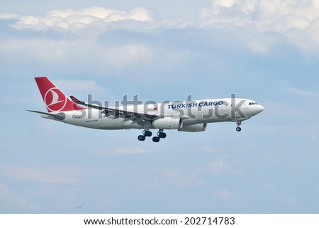 ISTANBUL, TURKEY - MAY 2, 2014: Turkish Cargo Airbus A330 landing at Istanbul Ataturk Airport.  This aircraft, TC-JCI, was delivered to Turkish Airlines Cargo in 2013.
