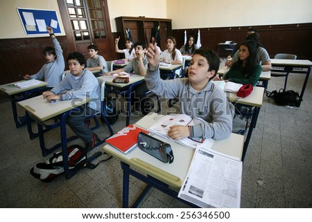 ISTANBUL, TURKEY - MAY 15: Turkish elementary school students attentively listening to teacher in the classroom on May 15, 2008 in Istanbul, Turkey.