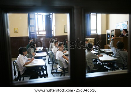 ISTANBUL, TURKEY - MAY 15: Turkish elementary school students attentively listening to teacher in the classroom on May 15, 2008 in Istanbul, Turkey.  - stock photo
