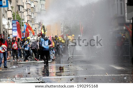 ISTANBUL, TURKEY-MAY 1: Turkish police fired water cannon and tear gas to prevent protesters from defying a ban on May Day rallies and reaching Taksim Square on May 1, 2014 in Istanbul, Turkey. - stock photo