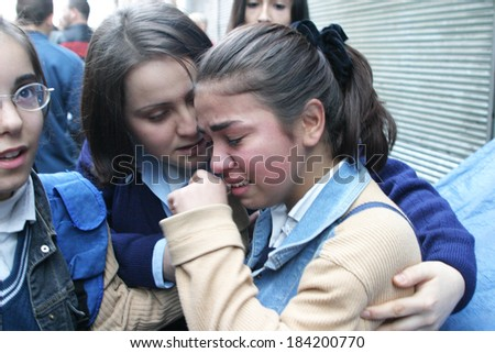 ISTANBUL, TURKEY - NOVEMBER 20: A girl crying after terror attack and bomb explosion in British Consulate on November 20, 2003 in Istanbul, Turkey. Killing 30 people and wounding 400 others.  - stock photo