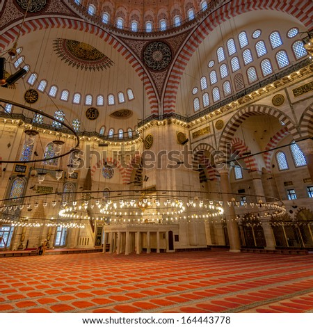 ISTANBUL, TURKEY - NOVEMBER 3,2013 - Inside of Suleymaniye Mosque in Istanbul.The interior of the mosque is almost a square, 59 meters in length and 58 meters in width, forming a single vast space.
