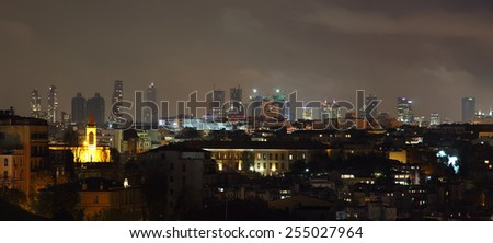 ISTANBUL, TURKEY - NOVEMBER 27:  Istanbul skyline of business buildings at night on November 27, 2014 in Istanbul, Turkey