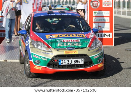 ISTANBUL, TURKEY - NOVEMBER 14, 2015: Umit Can Ozdemir with Ford Fiesta R2 of Castrol Ford Team Turkiye in ceremonial start of Isok Istanbul Rally 2015