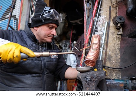 Istanbul,Turkey - November 20,2016 : Welding and bright sparks. Hard job.