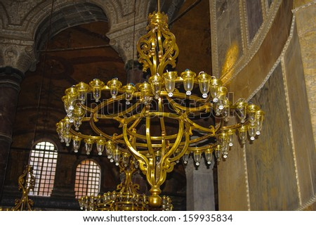 ISTANBUL, TURKEY - OCTOBER 24, 2013: Chandelier in Hagia Sophia mosque in Istanbul, Turkey, on October 24. 2013. Hagia Sophia was created in 537.