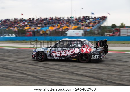 ISTANBUL, TURKEY - OCTOBER 12, 2014: Driver George Christoforou performs drift during FIA World Rallycross Championship.