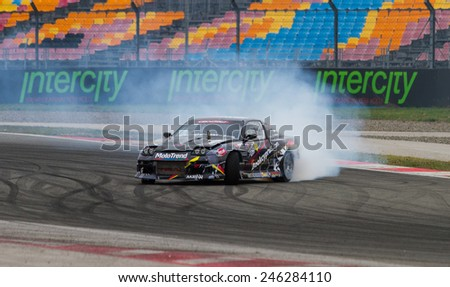 ISTANBUL, TURKEY - OCTOBER 12, 2014: Drivers Charalambos Tsouri and Luke Woodham perform drift during FIA World Rallycross Championship. - stock photo